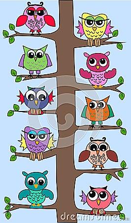 Cute owls in a tree