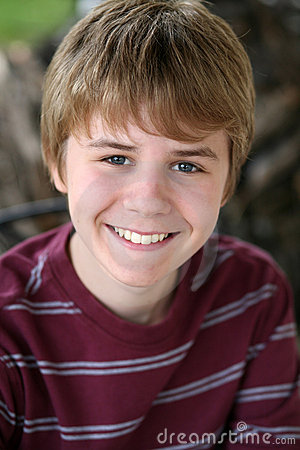 Cute preteen boy smiling