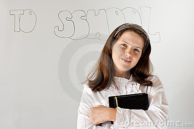 Cute preteen schoolgirl portrait near whiteboard