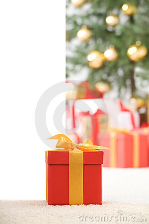 Cute red gift box with gold ribbon