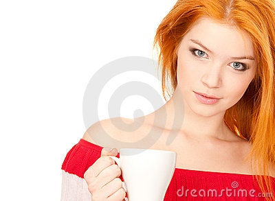 Cute redhead with white cup