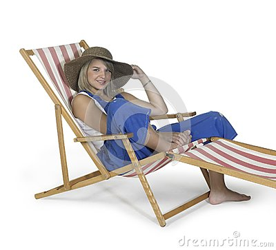 Cute relaxing girl in a canvas chair