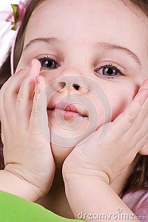 Cute sad little girl close-up