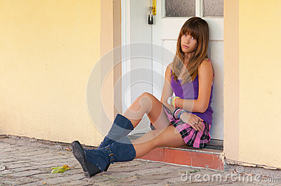 Cute Sad Teenage Girl Sitting In Front Of The Door Stock Image - Image ...