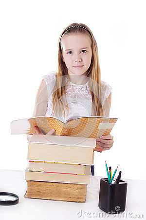 Cute schoolgirl with pile of books Stock Photo