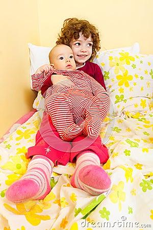 Cute siblings in bed
