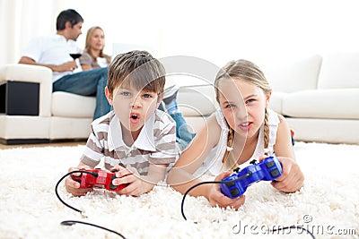 Cute siblings playing video games