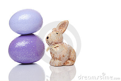 Cute small Easter bunny with Easter eggs