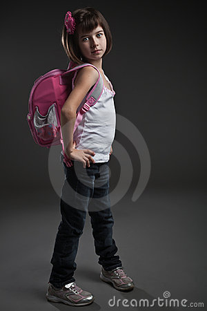 Cute small girl going to school