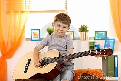 Cute small kid with guitar