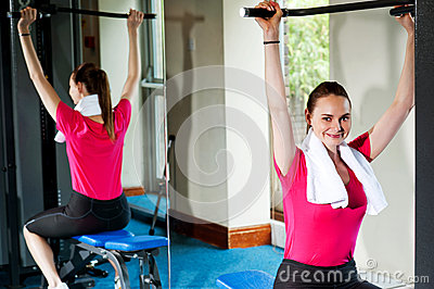 Cute smiling female working out