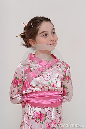 Cute smiling girl in Japanese masquerade costume