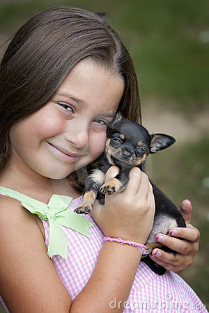 Cute smiling little girl with puppy
