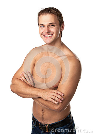 Cute smiling young guy in jeans with bare torso