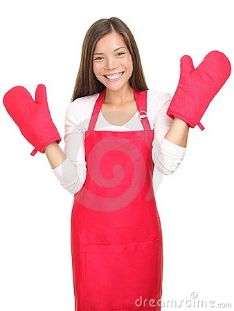 Cute smiling young woman with cooking mittens