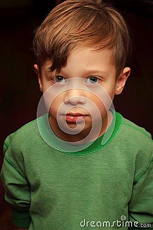 Cute Somber Sober Young Boy Sad Looking Yr Old Brown Hair Big Eyes Wearing Green Shirt Happy Stock Photo