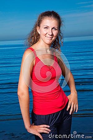 Cute sport girl at the beach