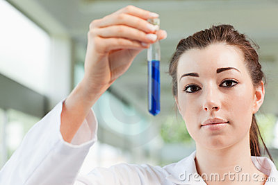 Cute student holding a test tube