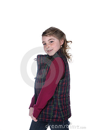 Cute stylish girl in plaid vest and freckles