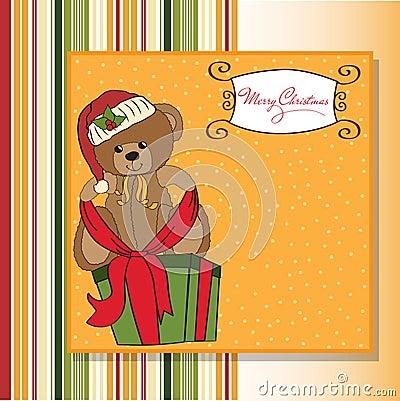 Cute teddy bear with a big Christmas gift