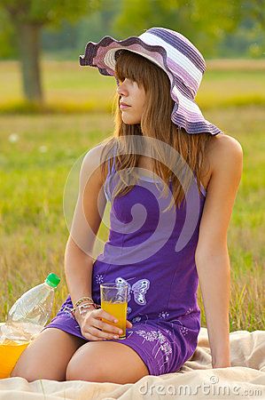 Cute teenage girl on the picnic