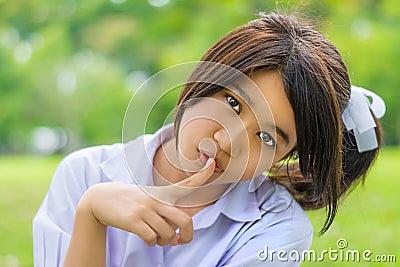 Cute Thai schoolgirl, hush gesture