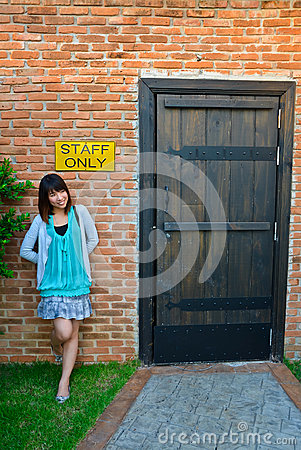 Cute Thai woman is standing outside the staff room