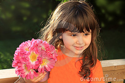 Cute three year old girl with flowers