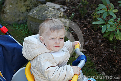 Cute toddler boy on children bycicle