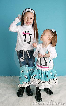 Cute toddler girl modeling a winter penguin outfit