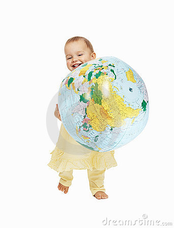 Cute toddler playing with the globe