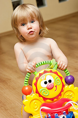 Cute toddler playing with toy