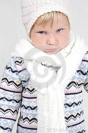 Cute toddler in winter clothes