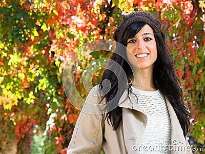 Cute woman in autumn