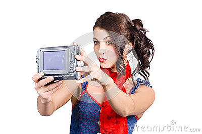 Cute woman filming tutorial with video camera