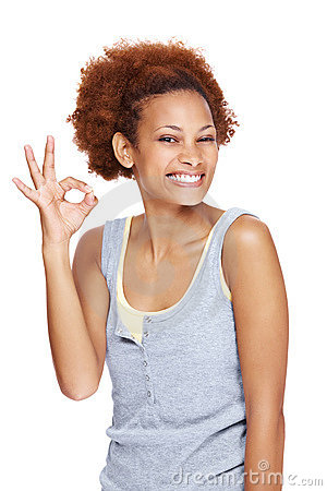 Cute woman gesturing okay sign over white