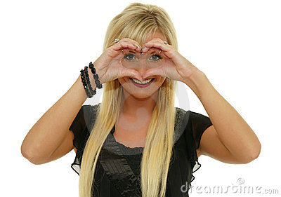 Cute woman making a heart shape with hands