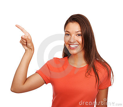 Cute woman pointing towards copyspace over white
