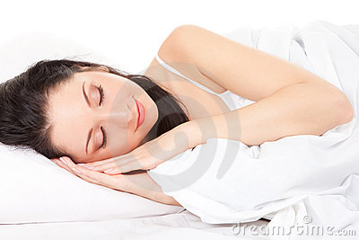 Cute woman sleeps on the bed