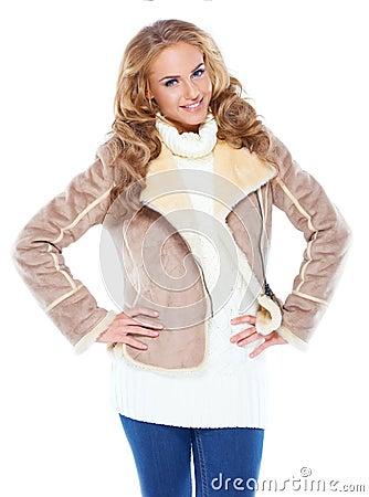 Cute woman wearing modern winter fur jacket