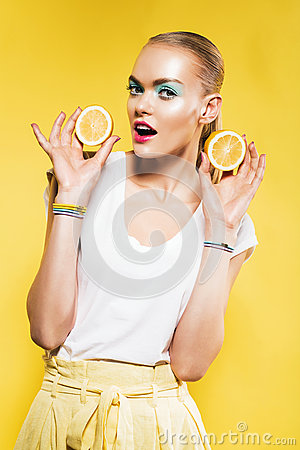 Free Cute Woman With Slice Of Lemons In Hand Royalty Free Stock Photo - 59541985