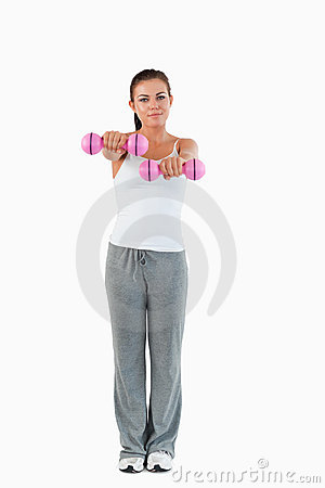 A cute woman working out with dumbbells