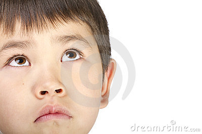 Cute young asian boy look up with a sad face