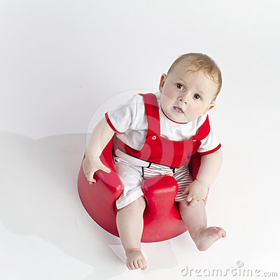 Cute young baby in chair