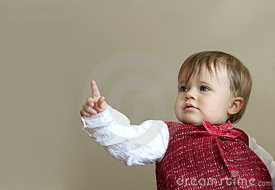 Cute young baby pointing