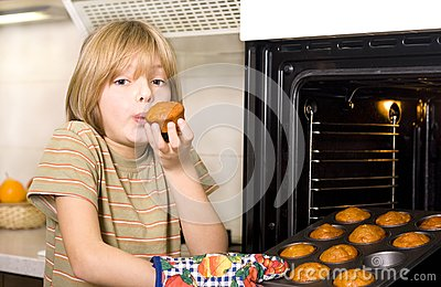 Cute young boy cooking