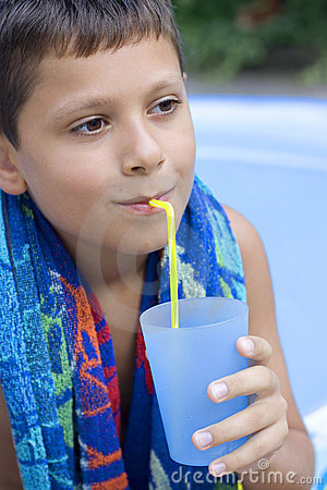 Cute young boy drink juice
