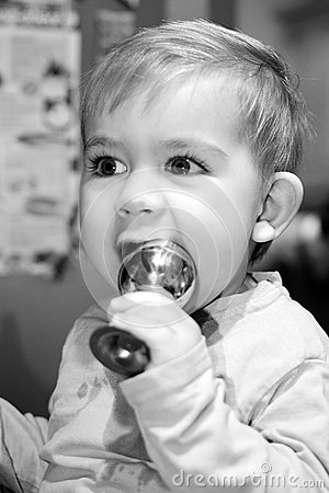 Cute Young Boy Holding a Cup