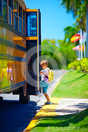Free Cute Young Boy, Kid Getting On The School Bus, Ready To Go To School Stock Photography - 59102912