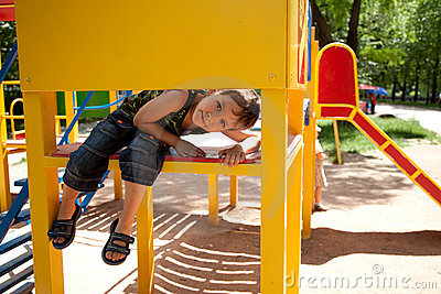 Cute young boy on playground Stock Photo